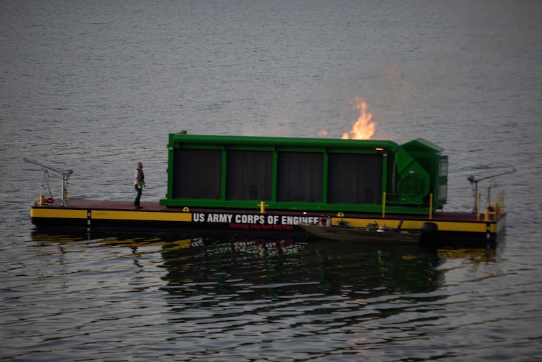 A new floating barge and air curtain burner incinerates debris early morning Oct. 21, 2020 on Lake Cumberland near Waitsboro Recreation Area in Somerset, Kentucky. (USACE Photo by Lee Roberts)