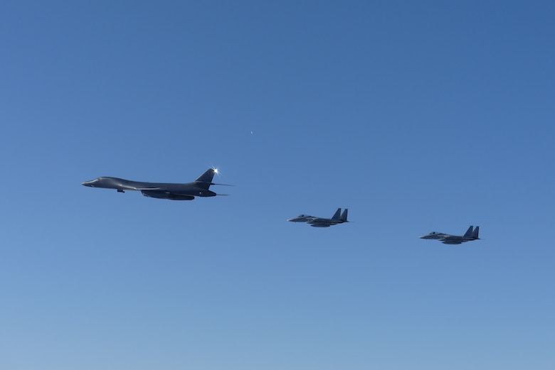 A B-1B Lancer, assigned to the 9th Expeditionary Bomb Squadron, Dyess Air Force Base, Texas, conducts training with two Koku-Jieitai (Japan Air Self Defense Force) F-15J fighters in the vicinity of the Sea of Japan, October 20, 2020.