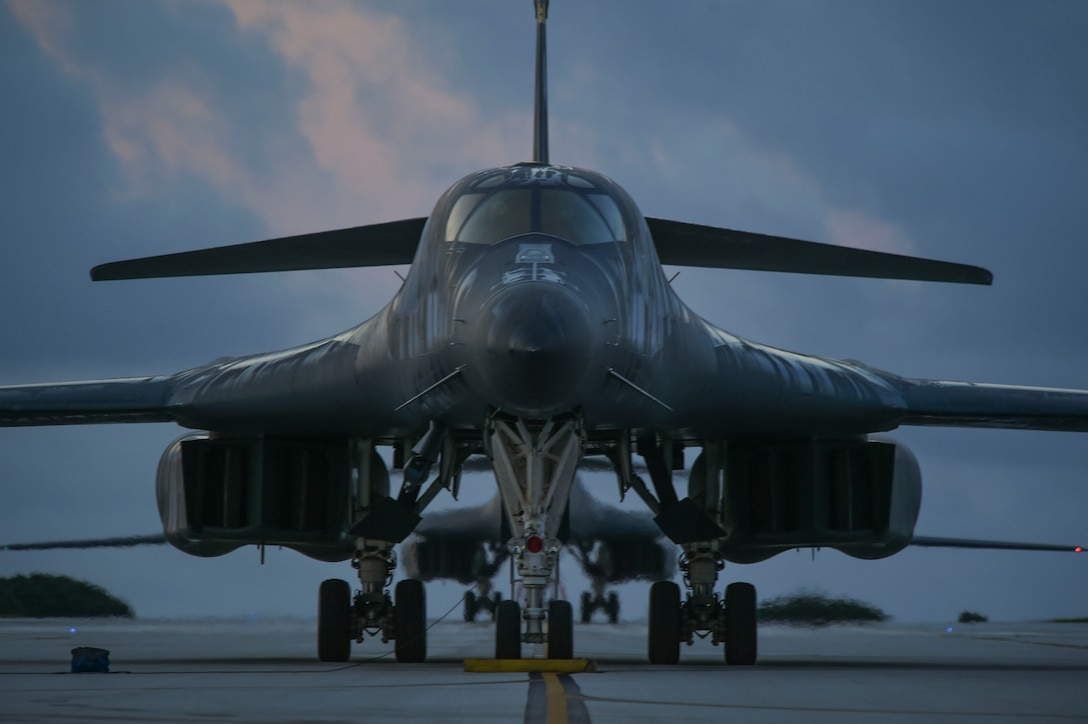 Two B-1B Lancer aircraft sit on a runway during a Bomber Task Force deployment at Andersen Air Force Base, Guam, Oct. 21, 2020.