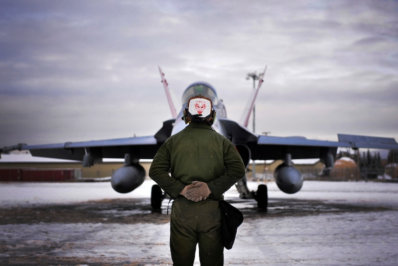 U.S. Marine Corps Cpl. Jeremy Waggoner, Jr., a Marine Fighter Attack Squadron (VMFA) 232 plane captain, stands by as a pilot prepares to taxi during RED FLAG-Alaska 21-1 at Eielson Air Force Base, Alaska, Oct 20, 2020.