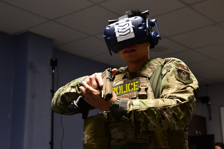 Staff Sgt. David Greenwood, 926th Security Forces Squadron training instructor, uses virtual reality to run through Use of Force training scenarios during the Mandatory Unit Training Assembly, Oct. 4, at Nellis Air Force Base, Nevada. (U.S. Air Force Photo by Senior Airman Brett Clashman)