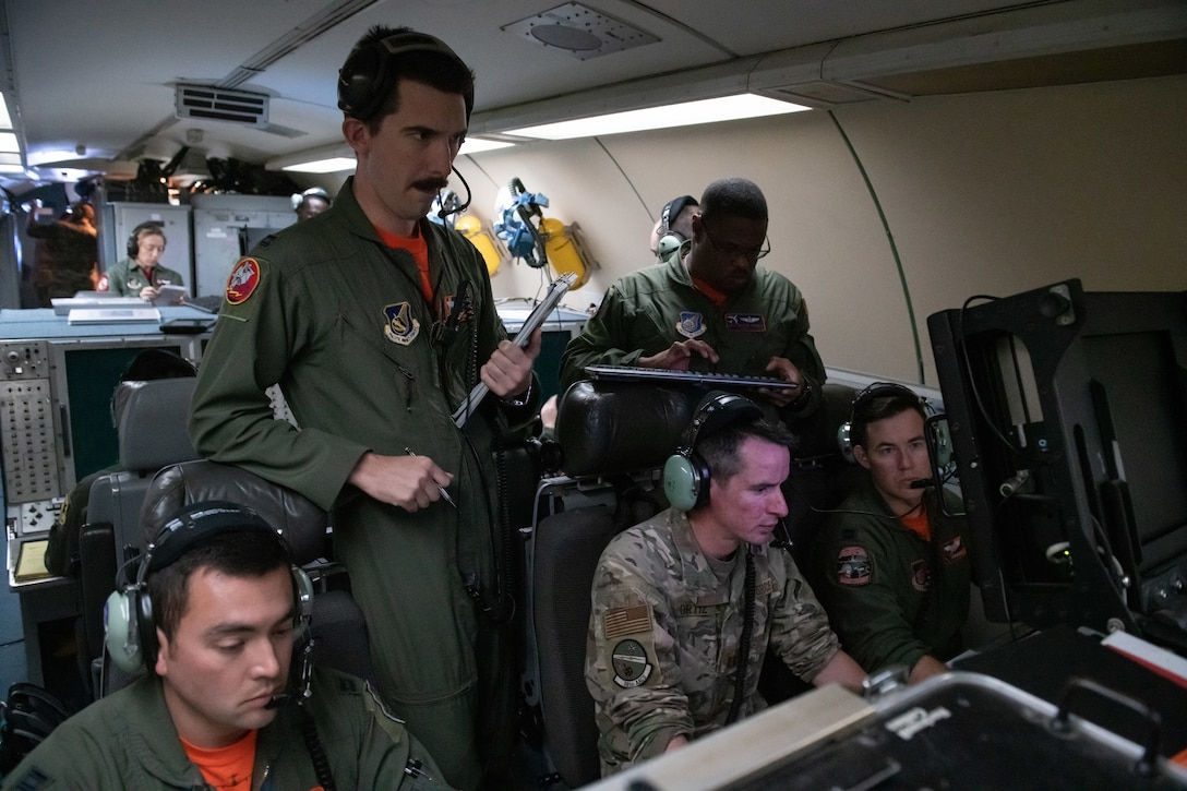 U.S. Airmen from the 961st Airborne Air Control Squadron monitor indication friend or foe systems aboard an E-3 Sentry during Exercise WestPac Rumrunner Oct. 16, 2020, out of Kadena Air Base, Japan. The 961st AACS was a critical piece of the exercise, which focused on defensive counter air capabilities and joint interoperability using agile combat employment concepts. ACE is the cornerstone of the wing's operating concept. It enables forces to operate from locations with varying levels of capacity & support, ensuring multi-functional Airmen are postured in a position of advantage to generate combat power. (U.S. Air Force photo by Staff Sgt. Peter Reft)