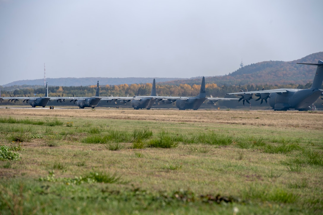 Photo of cargo aircraft performing and elephant walk
