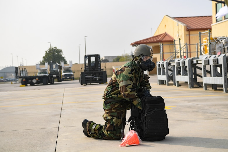 Airman 1st Class Zion Sizemore, 724th Air Mobility Squadron member, pulls equipment out of a bag during exercise Nodal Lightning at Aviano Air Base, Italy, Oct. 21, 2020. Sizemore was part of a Personnel Accountability Report team during the exercise. (U.S. Air Force photo by Airman 1st Class Thomas S. Keisler IV)