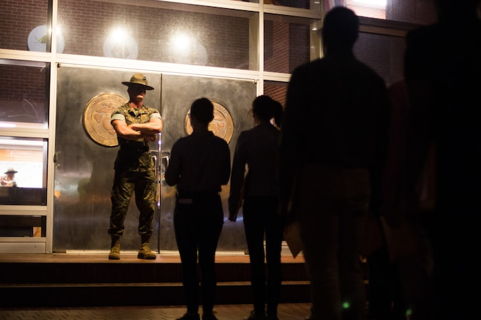 U.S. Marine Corps Staff Sgt. Richard Hibble, a senior drill instructor with Recruit Processing Company, Support Battalion, orders recruits of Bravo Company, 1st Recruit Training Battalion, and November Company, 4th Recruit Training Battalion, to walk through the iconic silver doors June 5, 2017, on Parris Island, S.C. Senior drill instructors, like Hibble, 28, from Kenilworth, N.J., are responsible for the accountability and administrative processing of new recruits before they start training with their company drill instructors. Bravo Company is scheduled to graduate Sept. 1, 2017. Parris Island has been the site of Marine Corps recruit training since Nov. 1, 1915. Today, approximately 19,000 recruits come to Parris Island annually for the chance to become United States Marines by enduring 12 weeks of rigorous, transformative training. Parris Island is home to entry-level enlisted training for approximately 49 percent of male recruits and 100 percent of female recruits in the Marine Corps. (U.S. Marine Corps photo by Lance Cpl. Carlin Warren)