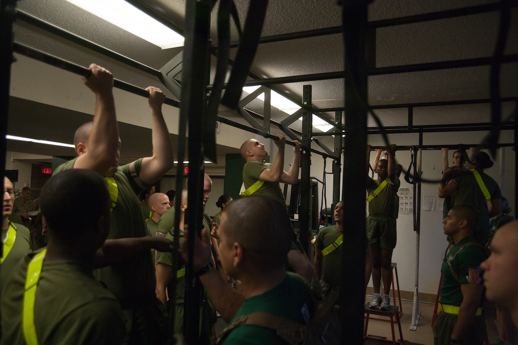 Recruits of Special Training Company, Support Battalion, do pullups during a physical training session July 10, 2013, Parris Island, S.C. Some recruits are removed from normal training due to medical or physical conditions that prevent them from safely progressing through recruit training. While assigned to the company, recruits rehabilitate in order to return to training where they left off. Approximately 20,000 recruits come to Parris Island annually for the chance to become United States Marines by enduring 13 weeks of rigorous, transformative training. Parris Island is home to entry-level enlisted training for 50 percent of males and 100 percent of for females in the Marine Corps. (Photo by Lance Cpl. David Bessey)