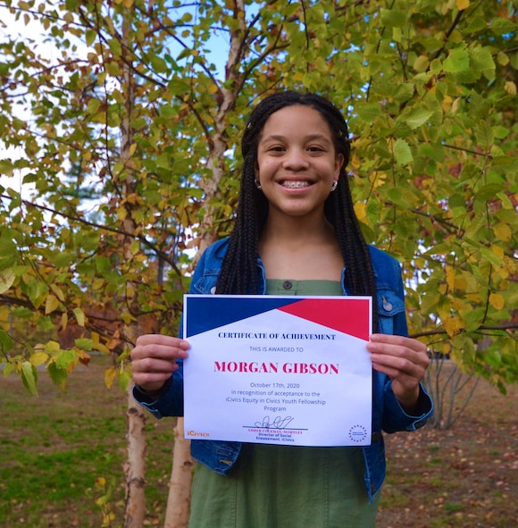 Morgan Gibson, an eighth grade student at Hanscom Middle School, poses with her iCivics National Equity Fellowship acceptance letter at Hanscom Air Force Base, Mass., Oct. 23. Gibson was one of 22 students selected nation-wide to participate in the student-leadership program that works to better the equity in civics in school curriculums. (courtesy photo)
