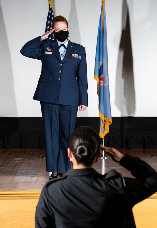 U.S. Air Force Col. Alice Briones, incoming Armed Forces Medical Examiner System director, presents her first salute during a change of directorship ceremony at Dover Air Force Base, Delaware, Oct. 21, 2020. AFMES provides the Department of Defense and other federal agencies comprehensive forensic investigative services, to include forensic pathology, DNA forensics, forensic toxicology and medical mortality surveillance. (U.S. Air Force photo by Senior Airman Christopher Quail)
