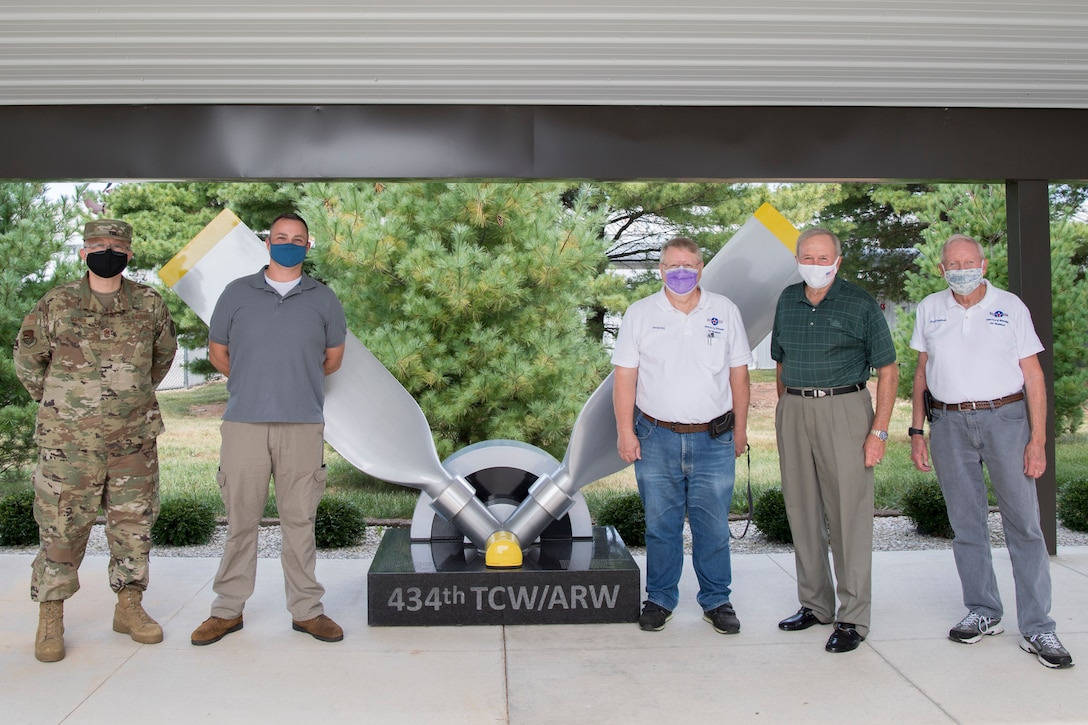 From the left, Chief Master Sgt. Wesley Marion, 434th Air Refueling Wing command chief, Brian Knowles, 434th ARW historian, pose for a photo with Atterbury-Bakalar Air Museum employees David Day, retired Air Force Maj. Gen. Mark Pillar, and Nick Firestone in front of the 434th monument at the museum in Columbus, Indiana, Sept. 17, 2020. Grissom personnel received a private tour of the facilities to learn more about the history and heritage of the 434th ARW. (U.S. Air Force photo/Master Sgt. Ben Mota)