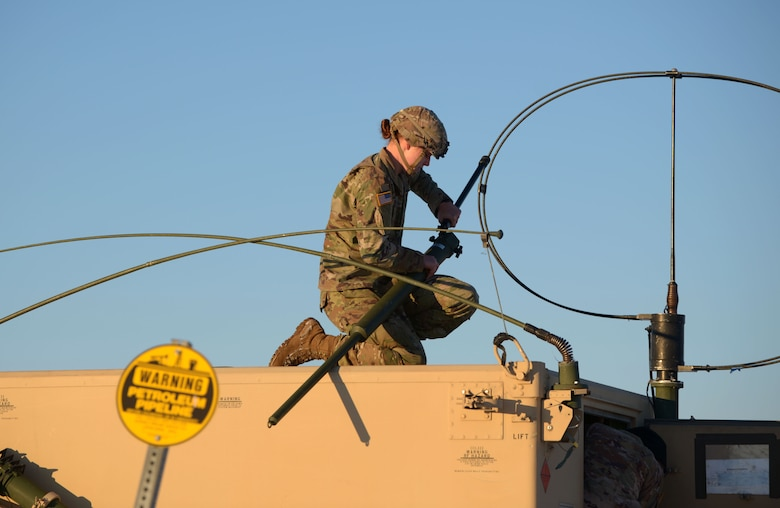 A U.S. Army Soldier fixes long-range radio equipment to a High Mobility Multipurpose Wheeled Vehicle at Fort Greely, Alaska, Oct. 22, 2020. Along with aerial training, RF-A features multiple ground elements that increase the overall readiness of the U.S. military. (U.S. Air Force photo by Senior Airman Beaux Hebert)