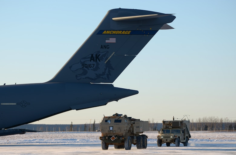 A U.S. Army M142 High Mobility Artillery Rocket System is unloaded from a C-17 Globemaster at Fort Greely, Alaska, Oct. 22, 2020. This iteration of RF-A focused mainly on joint integration of U.S. military branches.(U.S. Air Force photo by Senior Airman Beaux Hebert)