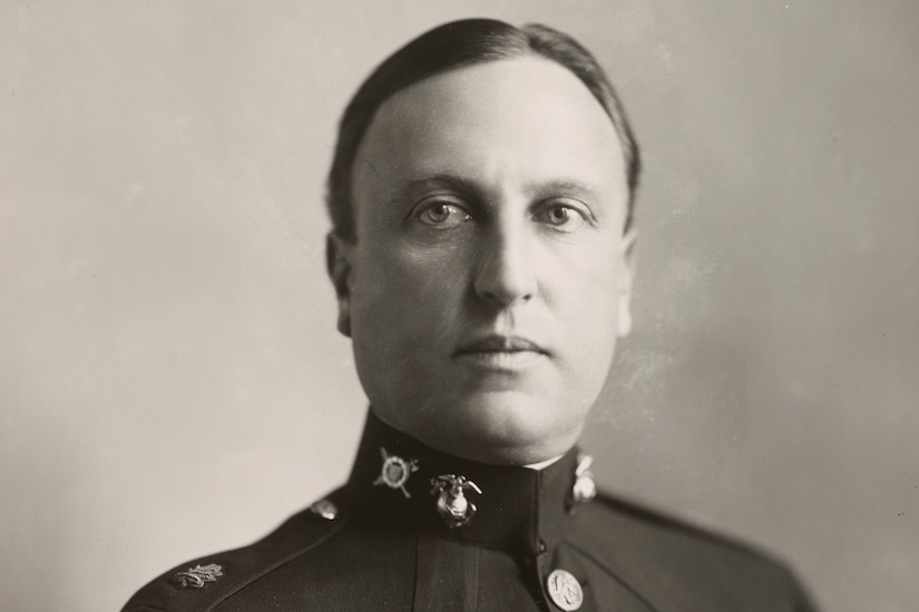 A man in uniform poses for a photo.