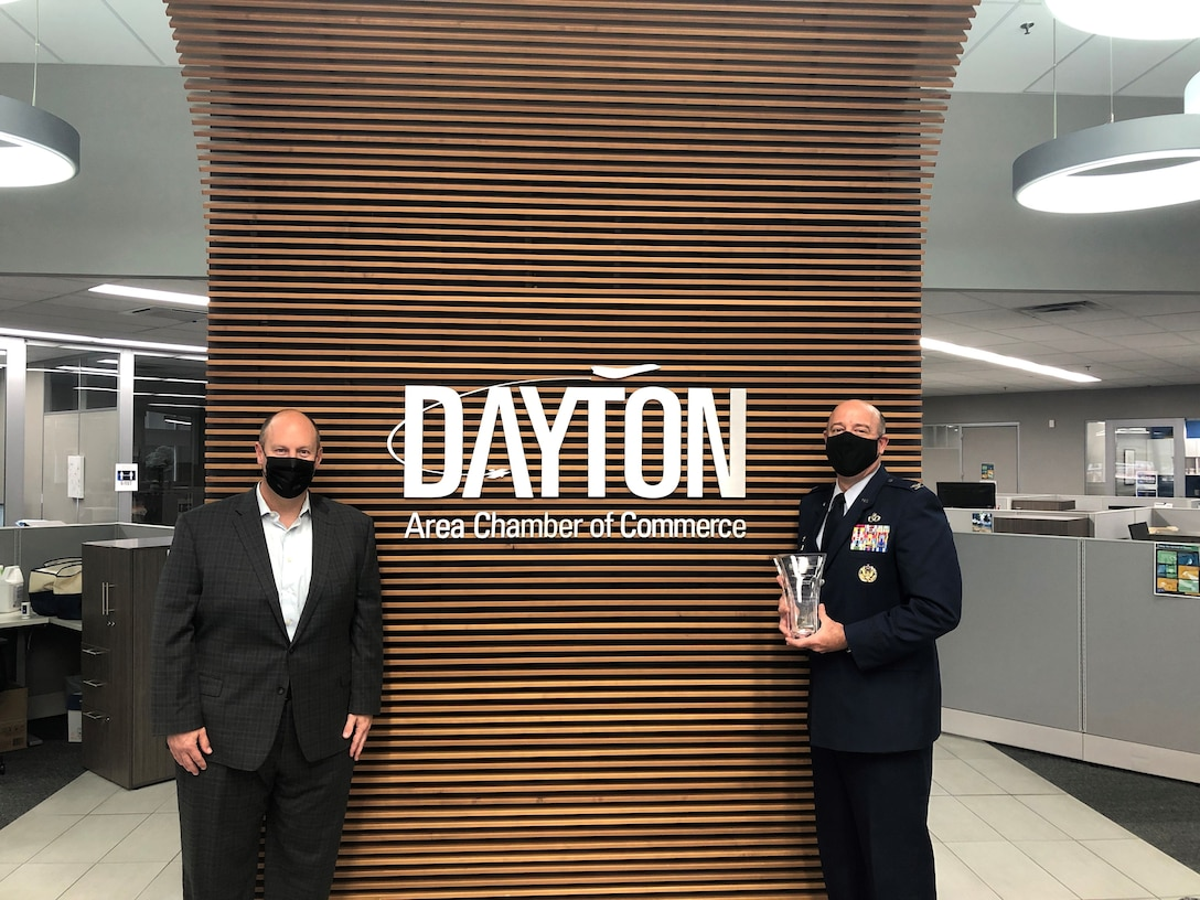 Col. Patrick Miller, 88th Air Base Wing commander, accepts the Program Partner of the Year Award on the installation's behalf. The award recognizes WPAFB's commitment to Leadership Dayton and the Dayton Area Chamber of Commerce.