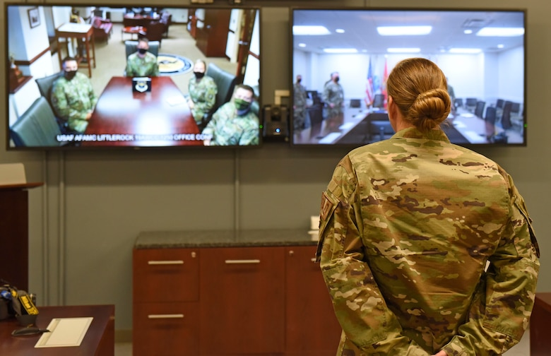 Airmen stands in front of Video Teleconference Center