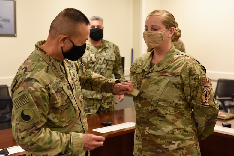 U.S. Army Maj. Gen. changes out rank for  U.S. Air Force Tech. Sgt.