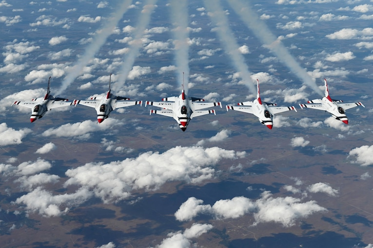 Six aircraft perform midair.