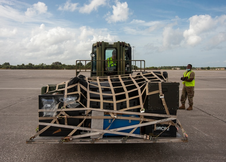 Airmen from the 6th Logistics Readiness Squadron at MacDill Air Force Base, Fla., use a 10K Standard Forklift, Oct. 21, 2020, to set a pallet on the flightline. The pallet contained deployment gear for an exercise to test the global mobility of the crew. (U.S. Air Force Photo by A1C David D. McLoney)