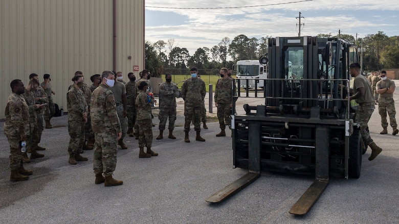Deployers gather at the deployed unit center for instruction on how to operate the 10K Standard Forklift, Oct. 23, 2020, at MacDill Air Force Base, Fla. The training included safety guidelines and basic operations, along with hands-on practice. (U.S. Air Force Photo by A1C David D. McLoney)