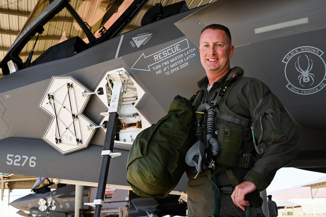 A photo of Lt. Col. Jared Santos, first USAF pilot to reach 1,000 hours in and F-35.