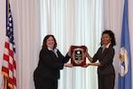 DCAA's Director Anita Bales presents the Grechanik-Collins Professional Employee Award to Ms. Debra Fletcher.