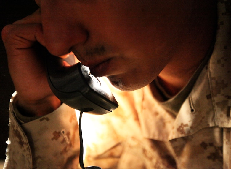 """Marine on the phone calling the """"DSTRESS"""" hotline"""
