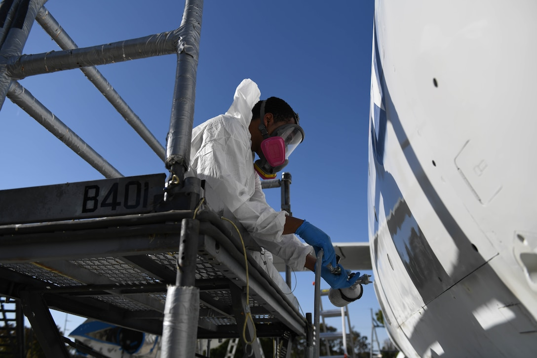 U.S. Air Force Airman 1st Class Tracy Bethea, 509th Maintenance Squadron low-observable maintenance technician, paints the side of the Boeing B-47 Stratojet hull on display at Whiteman Air Force Base, Missouri, Oct. 13, 2020. The aircraft's restoration had to meet the standards set by the United States Air Force Museum. (U.S. Air Force photograph by Airman 1st Class Devan Halstead)