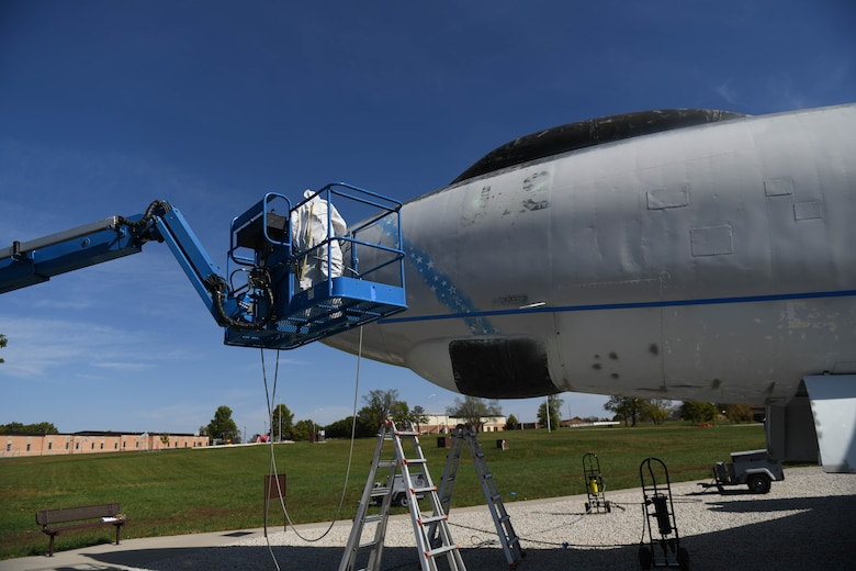 U.S. Air Force Tech. Sgt. Donald Curran, 509th Maintenance Squadron low-observable maintenance technician, uses a lift to check the front of the Boeing B-47 Stratojet static display at Whiteman Air Forces Base, Missouri on Oct. 14, 2020. Mobile lifts were required to reach many areas of the aircraft during its renovation. (U.S. Air Force photograph by Airman 1st Class Devan Halstead)