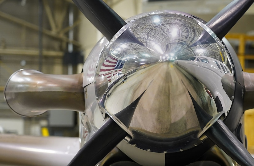 An America flag is reflected in one of the turboprop nose cones of a C-12F Huron, Oct. 22, 2020, in a hangar on Joint Base Elmendorf-Richardson, Alaska. The Huron is a versatile twin-engine turboprop primarily used by the military for limited passenger and light cargo transport, embassy support, and medical evacuation if needed.