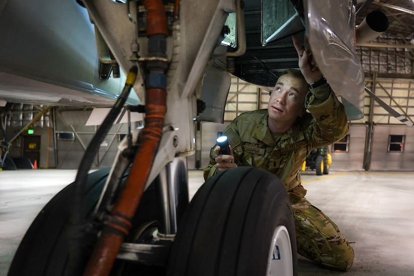 U.S. Air Force pilot 1st Lt. Keith Schaper, a native of Arcadia, Fla., assigned to the 517th Airlift Squadron at Joint Base Elmendorf-Richardson, Alaska, performs a pre-flight inspection on a C-12F Huron, Oct. 22, 2020.