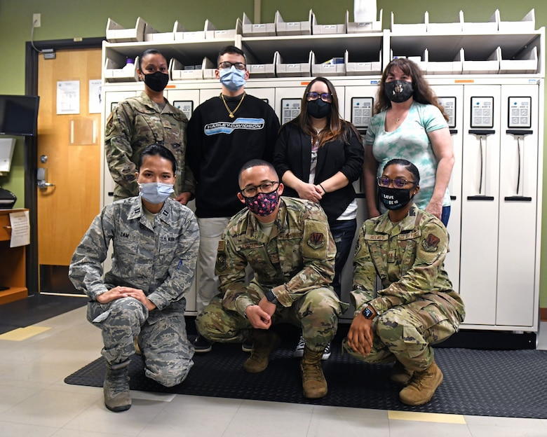 Members of the 9th Healthcare Operations Squadron pharmacy pose for a group photo, Oct. 23, 2020, at Beale Air Force Base, California. The Airmen and civilian contractors working at the pharmacy are an integral part of keeping Airmen and their families healthy. (U.S. Air Force photo by Airman 1st Class Luis A. Ruiz-Vazquez)