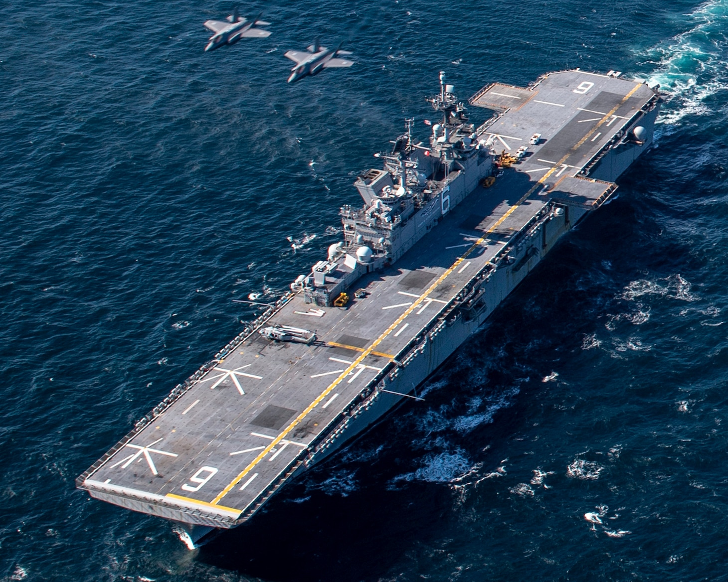 F-35 Lightning II aircraft  assigned to the Japan Air Self-Defense Force conduct integrated air operations with the forward-deployed amphibious assault ship USS America (LHA 6).