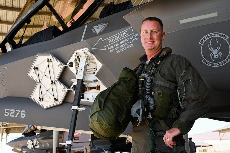A photo of Lt. Col. Jared Santos. First Air Force pilot to reach 1,000 hours in the F-35A Lightning II