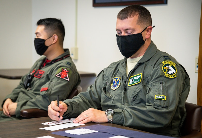 Capt. Dustin Martin, 2nd Bomb Wing weapons systems officer instructor, grades tests in preparation for Global Thunder 21 at Barksdale Air Force Base, La., Oct. 23, 2020. U.S. Strategic Command's fundamental mission is to deter, detect and prevent strategic attack against the United States, our allies and partners. (U.S. Air Force photo by Senior Airman Lillian Miller)