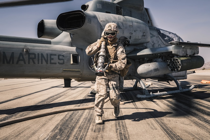 Marine refuels AH-1Z Viper at forward arming and refueling point during Integrated Training Exercise 1-21 at Marine Air Ground Combat Center Twentynine Palms, California, October 16, 2020 (U.S. Marine Corps/Zachary Zephir)