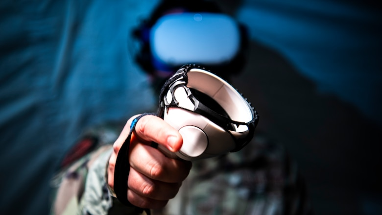 A U.S. Air Force Airman from the 366th Fighter Wing uses virtual reality during Agile Flag 21-1 at Tyndall Air Force Base, Florida, Oct. 23, 2020. Virtual reality is an innovative service provided by the 366th FW chaplaincy that can be used in deployed environments to let Airmen experience environments that hold sentimental value and boost morale. For instance, an Airman can go virtually fishing at their family's favorite fishing hole. (U.S. Air Force photo by Senior Airman Andrew Kobialka)