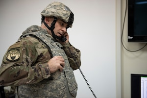 U.S. Air Force Master Sgt. Marshall Ritenour, 386th Expeditionary Civil Engineer Squadron requirements and optimization section chief, answers the phone during the Air and Missile Defense Exercise 21-1 at Ali Al Salem Air Base, Kuwait, Oct. 22, 2020.