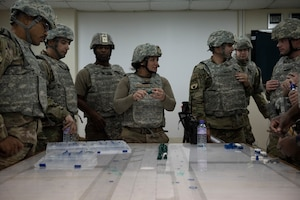 U.S. Air Force Airmen from the 386th Expeditionary Civil Engineer Squadron prepare a tabletop exercise in response to a simulated attack during the Air and Missile Defense Exercise 21-1 at Ali Al Salem Air Base, Kuwait, Oct. 22, 2020.