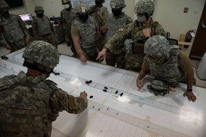 U.S. Air Force Airmen from the 386th Expeditionary Civil Engineer Squadron perform a tabletop exercise after a simulated attack during the Air and Missile Defense Exercise 21-1 at Ali Al Salem Air Base, Kuwait, Oct. 22, 2020.