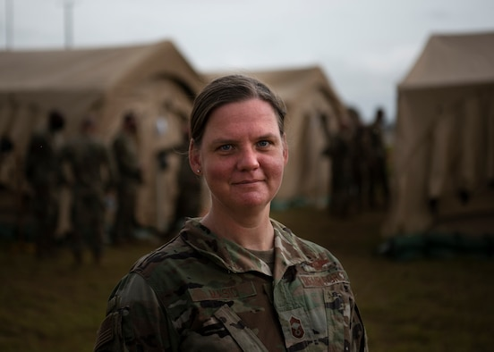 U.S. Air Force Chief Master Sgt. Emily Masic, 366th Fighter Wing superintendent, stands in front of the mobile operating base for Agile Flag 21-1, at Tyndall Air Force Base, Florida, Oct. 24, 2020. Masic's role throughout the exercise is tie everyone together in the A-staff to ensure mission success.  When problems arise, she is able to connect Airman to Airman to expedite the problem solving process. (U.S. Air Force photo by Senior Airman Andrew Kobialka)