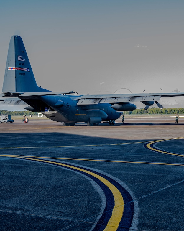 A U.S. Air Force Reserve C-130H Hercules aircraft assigned to the 910th Airlift Wing, based at Youngstown Air Reserve Station, Ohio, and equipped with a Modular Aerial Spray System, starts engines prior to taking off from Barksdale Air Force Base, Louisiana, Oct. 22, 2020.