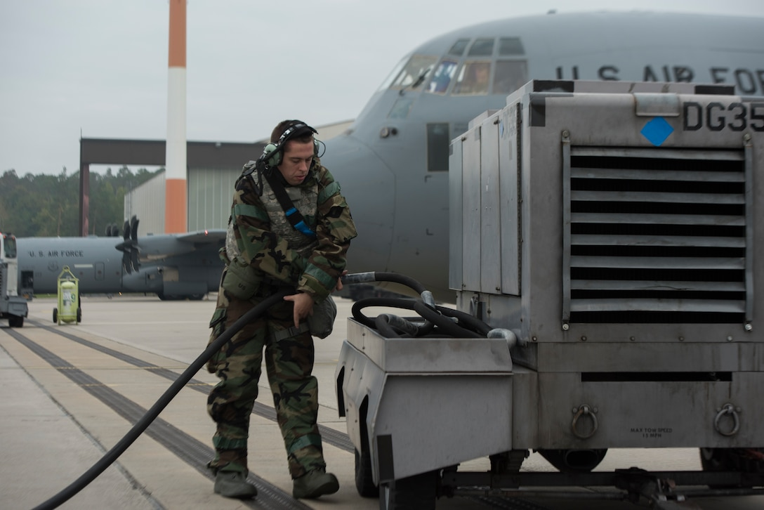 An Airman returns a pump to a generator.