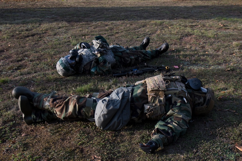 Two Airmen act as victims during an exercise Operation Varsity exercise.