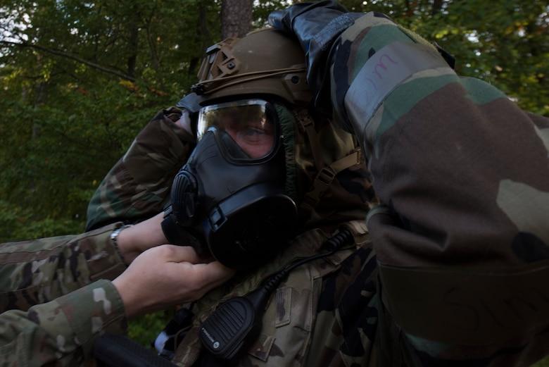 An Airman adjusts his chemical gear.