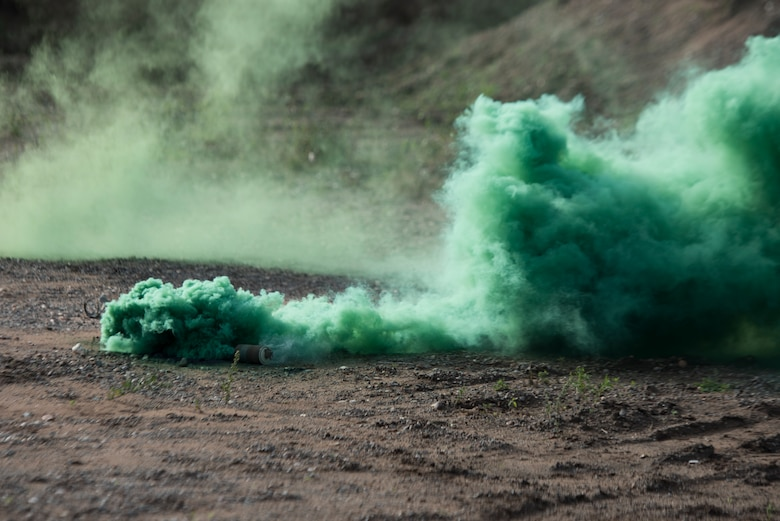 A smoke grenade canister is set off.