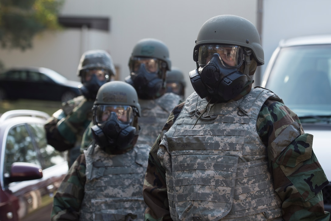 An Airmen waits for further instruction in a simulated decontamination line.