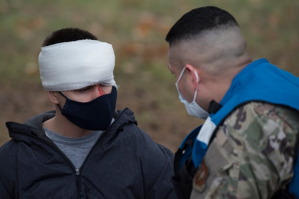 An Airmen speaks with a simulated victim.