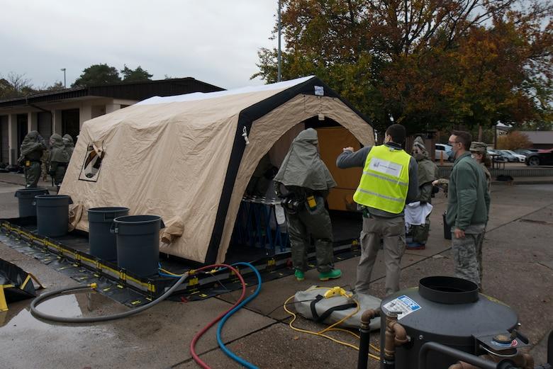 Airmen use a decontamination tent.