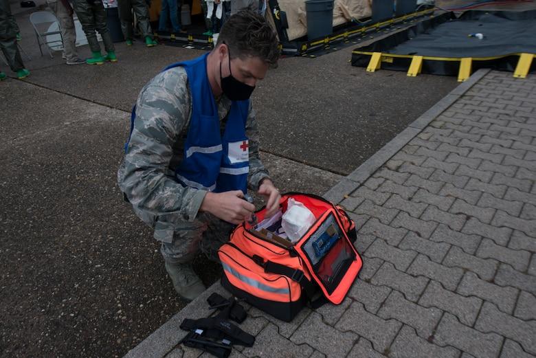 An Airmen obtains medical supplies.