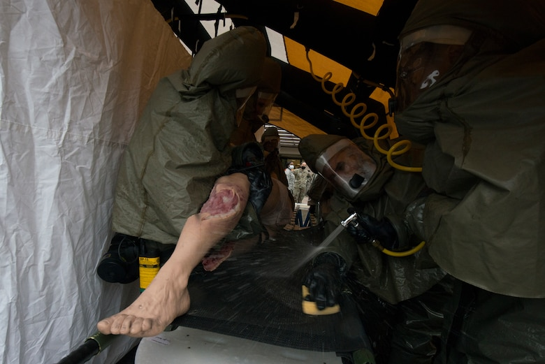 A simulated victim is decontaminated in a decontaminated tent.