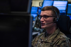 U.S. Army 1st Lt. Andrew Plautz, 11th Air Defense Artillery (ADA) Brigade ADA fire control officer, relays information during Air Missile and Defense Exercise (AMDEX) 21-1 at Al Dhafra Air Base, United Arab Emirates, Oct. 23, 2020.